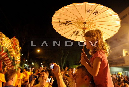 A girl watches the Spring Festival celebration in the Chinatown of Johannesburg, South Africa, on Feb. 16.