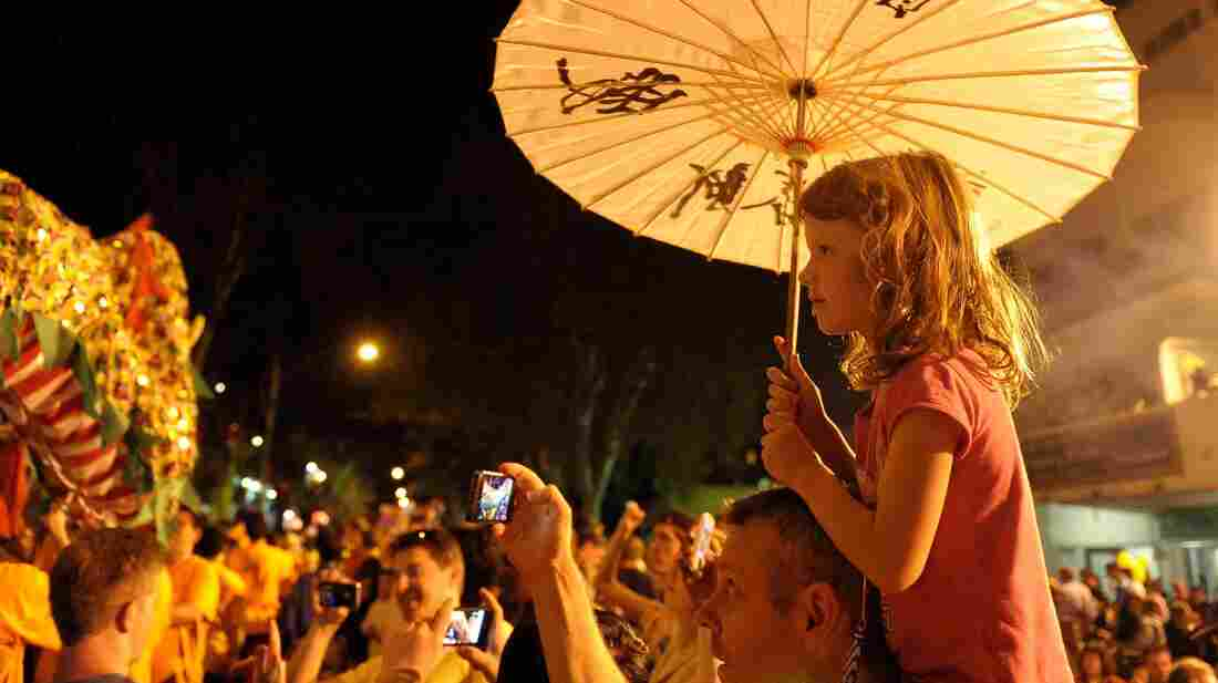 A girl watches the Spring Festival celebration in the Chinatown section of Johannesburg, South Africa, on Feb. 16.