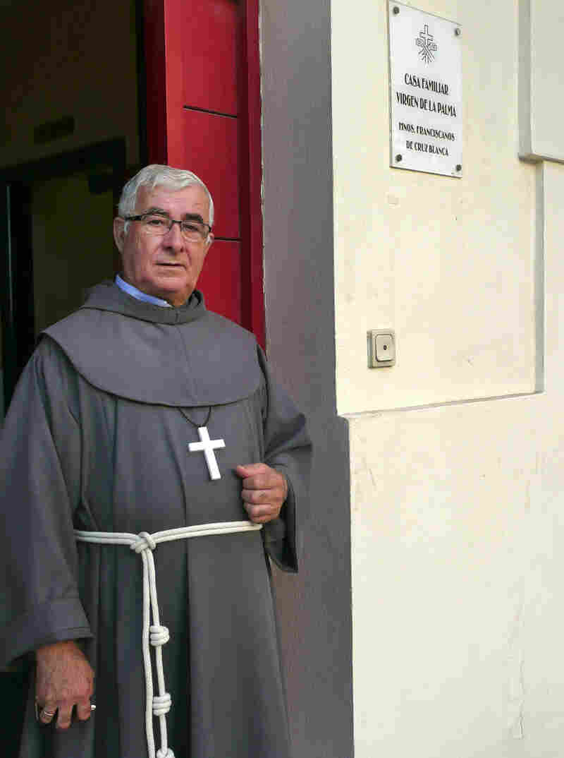 """Isidoro Macías Martín, aka """"Padre Patera,"""" stands in front of his monastery office across the street from the port of Algeciras, in southern Spain. Martín is a Franciscan brother who for 40 years has been the first point of contact in Spain for thousands of Africans arriving illegally by boat."""