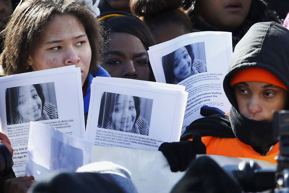 Protesters at an anti-gun violence rally in Chicago in February hold up photos of 15-year-old Hadiya Pendleton at the scene where she was killed Jan. 29. She was shot dead two weeks after she performed at President Obama's second inauguration. (AP)