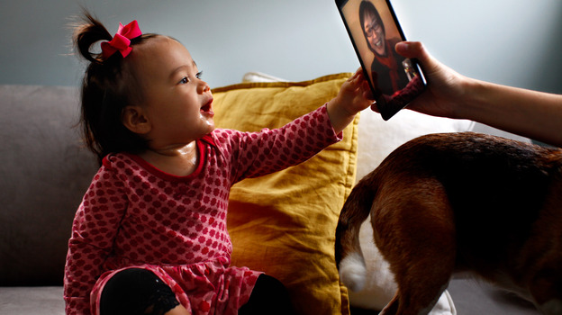 Eva Hu-Stiles virtually interacts with her grandmother. iPad assist by Elise Hu-Stiles. (NPR)