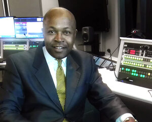 Victor Holliday, writer and producer of NPR fundraising promotional spots, in the studio.