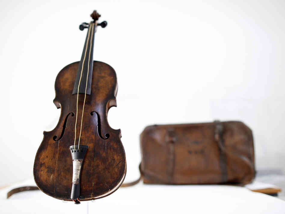 This violin is said to have been played by bandmaster Wallace Hartley during the final moments before the sinking of the Titanic. It's thought he put the instrument in that leather case. Hartley's body and the case we