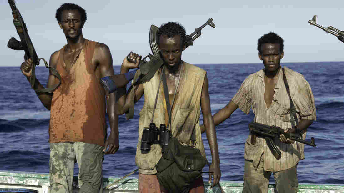 Barkhad Abdi (center) learned to swim, navigate small skiff boats, handle weapons — and act — for the film Captain Phillips.