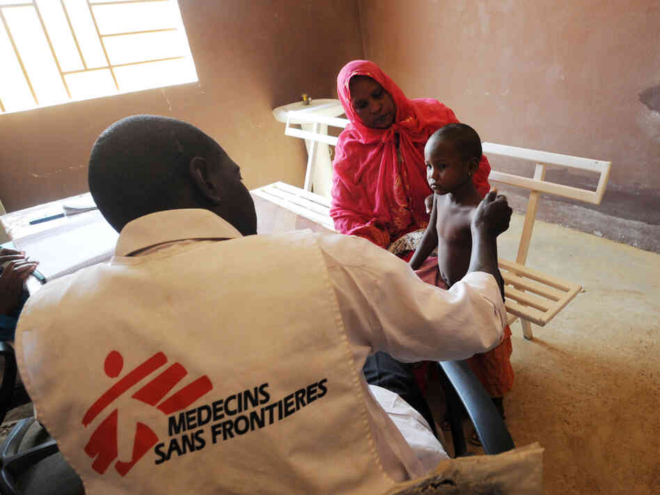 A worker from Doctors Without Borders speaks with a sick child in Gao, in the north of Mali, on Feb. 4.