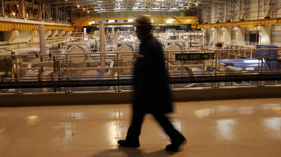 A worker walks inside the turbine hall of the Sizewell nuclear plant in eastern England in 2006. The U.K. government on Monday announced that French-owned EDF would build the first new British nuclear power station in 20 years.