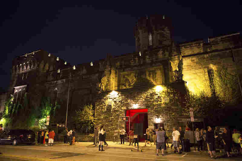 """Visitors wander near the entrance to """"Terror Behind The Walls."""" The penitentiary lay dormant for 20 years until preservationists convinced the city to keep it as a historic site."""
