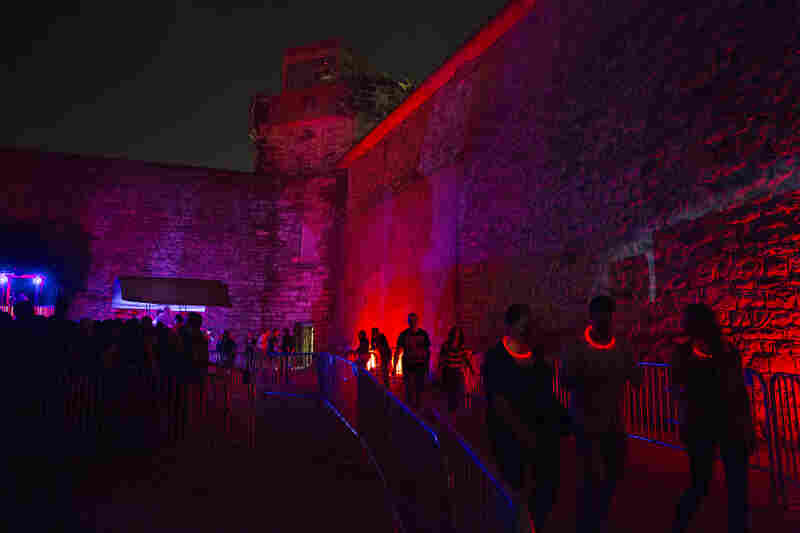 """Visitors, some with """"high-tech tracking devices,"""" wait to enter the penitentiary. In 2011, the haunted attraction raised 63 percent of the historic site's operating budget."""