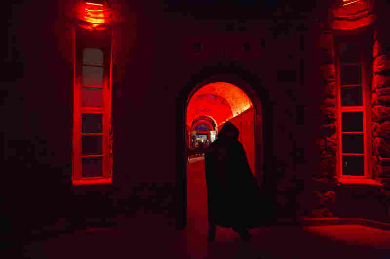 "An actor lurks in the Eastern State Penitentiary rotunda during ""Terror Behind The Walls,"" in Philadelphia. At night, the former prison transforms into America's largest haunted attraction outside of a theme park."
