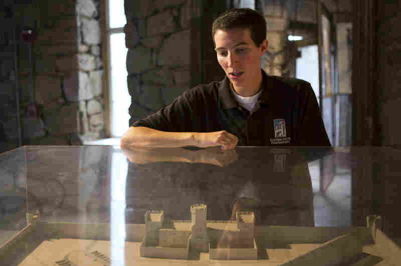 Ben Bookman, a tour guide at Eastern State Penitentiary, uses a diorama to point out the prison's cellblocks.