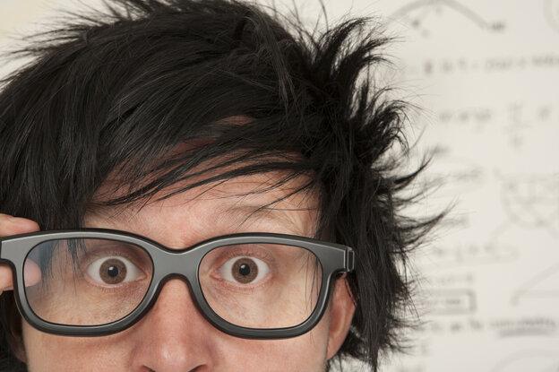Closeup photograph of a man wearing glasses.