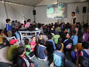 Mercy Corps organizes games and movies at the Zaatari camp to help children return to more normal activities and routines.