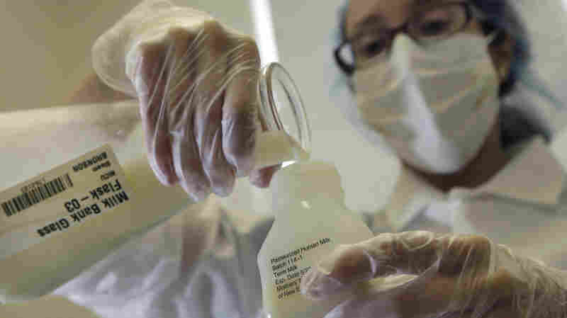 A lab technician at the Mothers' Milk Bank Northeast in Newton Upper Falls, Mass., prepares donated breast milk for pasteurization in August 2012. The process kills harmful bacteria.