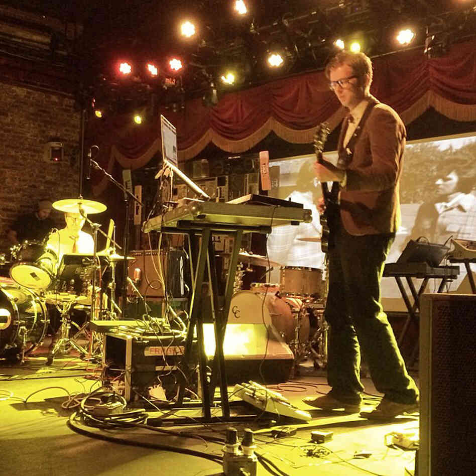 """This may be the best new thing for me at CMJ: complete with robot voice, banjo, samples, drums, and film... and they rock. It's the multimedia group Public Service Broadcasting."" - Bob Boilen"