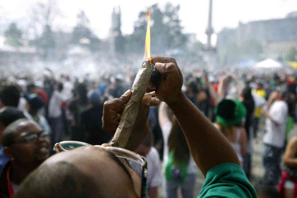 A person identifying himself as Jermagisty Tha King of Denver lights up a 28 ounce blunt on April 20, 2012 in Denver, Colo.