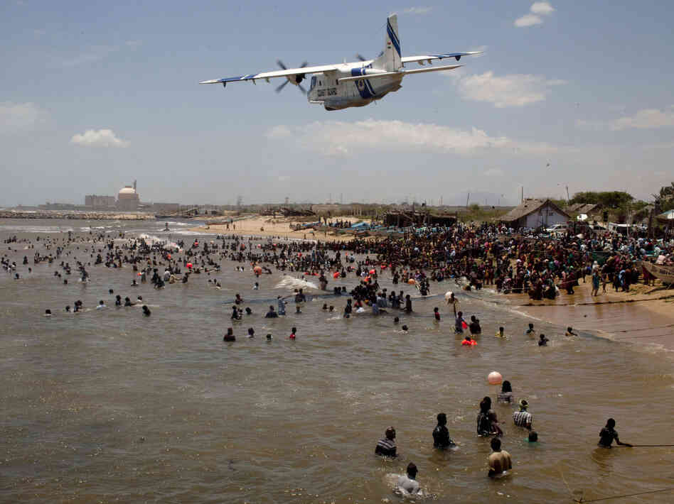 An Indian Coast Guard plane flies over hundreds of anti-nuclear activists during a protest last year. The Kun