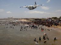 An Indian Coast Guard plane flies over hundreds of anti-nuclear activists during a protest last year. The Kundankulam Nuclear Power, still under construction, can be seen in the distance.