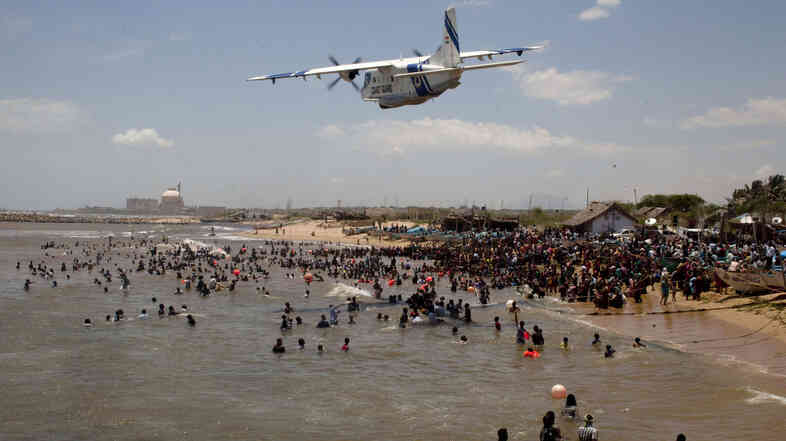 An Indian Coast Guard plane flies over hundreds of anti-nuclear activists during a protest last year. The Kunda