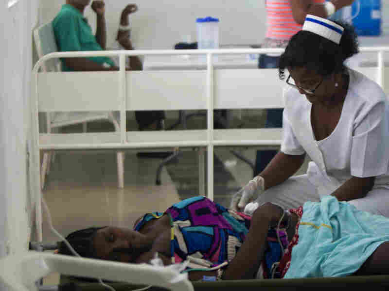 A nurse treats a cholera patient at the Juan Pablo Pina Hospital in San Cristobal, Dominican Republic, in August. Health officials say that the strain of cholera circulating in the country— the same one that first appeared in Haiti three years ago — has also caused outbreaks in Cuba and now Mexico.