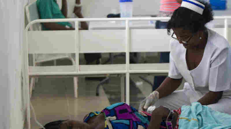 A nurse treats a cholera patient at the Juan Pablo Pina Hospital in San Cristobal, Dominican Republic, in August. Health officials say that the strain of cholera circulating in the country— the same one that first app