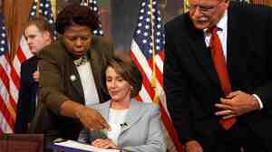 Clerk of the House Lorraine Miller discusses legislation with then-Speaker of the House Nancy Pelosi during a 2007 signing ceremony.