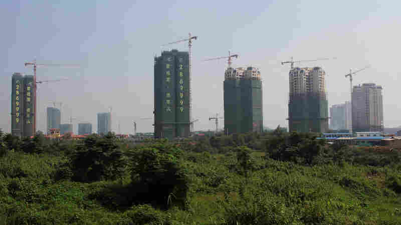 Apartment blocks rise in Chenzhou, where the government is building a new city with an industrial park to develop the economy and urbanize the area.