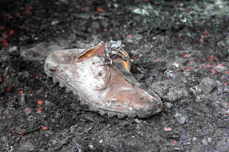 One of He's shoes sits amid the ash that carpets the room where he lit himself on fire.