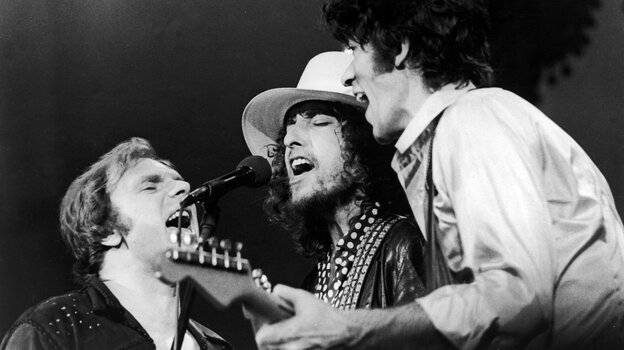 Van Morrison, Bob Dylan and The Band's Robbie Robertson (from left to right) onstage in 1976. The performance was filmed for Martin Scorsese's The Last Waltz.