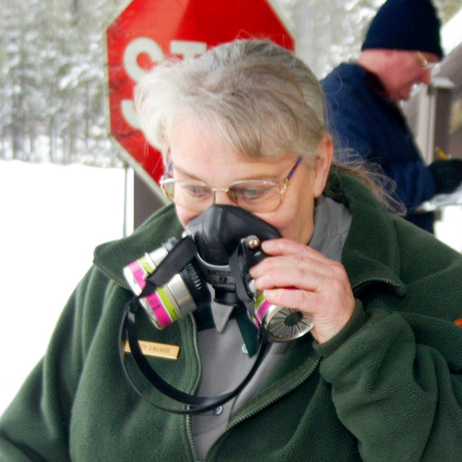 Snowmobile exhaust has been so bad that respirators like this one worn by park worker Kitty Eneboe in 2003 have been needed for protection.