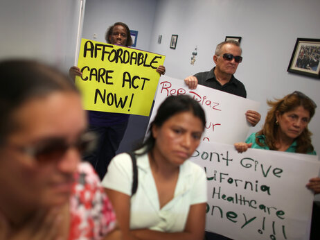 Protesters fill the Miami office of Florida state Rep. Manny Diaz Jr. on Sept. 20 to protest his stance against expansion of health coverage in the state.