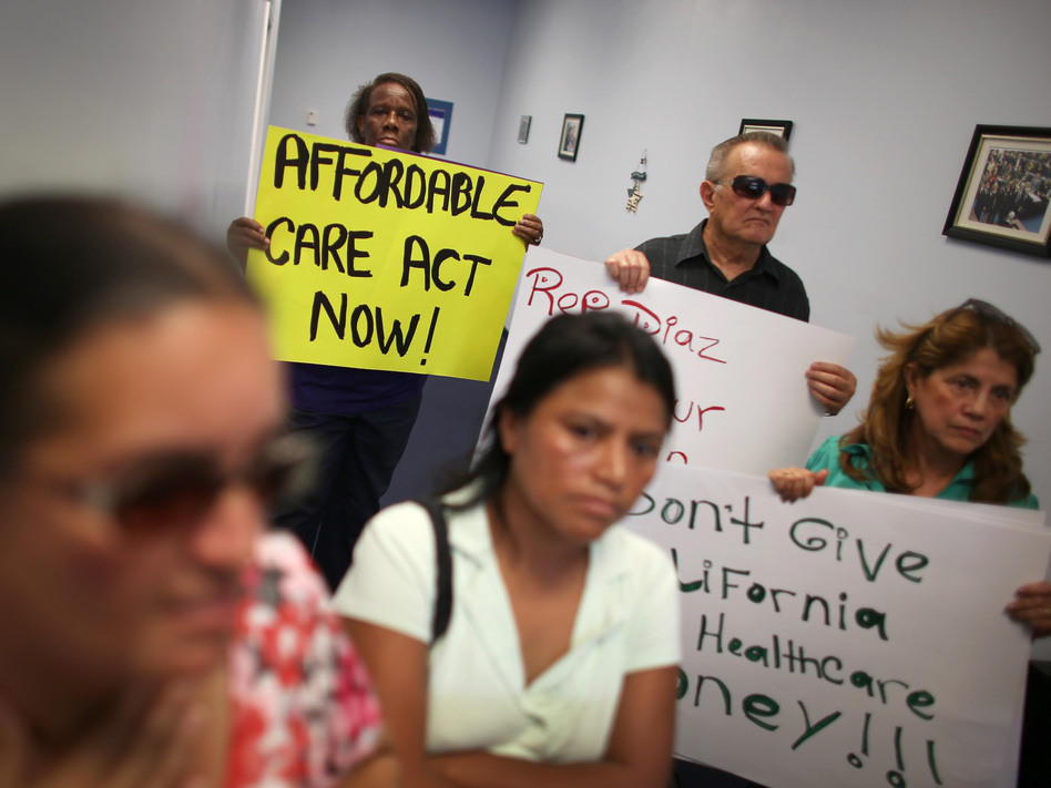 Protesters fill the Miami office of state Rep. Manny Diaz Jr. on Sept. 20 to protest his stance against expansion of health coverage in Florida. (Joe Raedle/Getty Images)