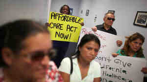 Protesters fill the Miami office of state Rep. Manny Diaz Jr. on Sept. 20 to protest his stance against expansion of health coverage in Florida.