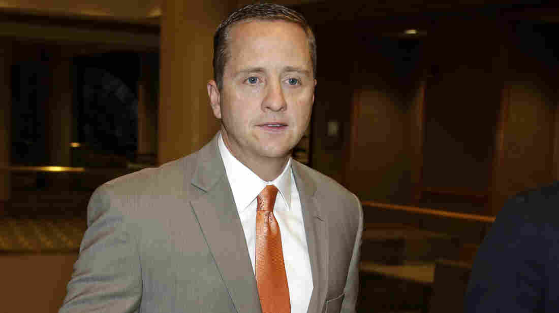 "The University of Miami's athletic director, Blake James, walks to an NCAA Committee on Infractions hearing in Indianapolis in June. The school's failings ""enabled a culture of noncompliance,"" the NCAA said Tuesday, in announcing penalties for the school and its football and men's basketball coaches."