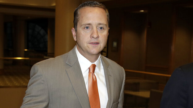 "The University of Miami's athletic director, Blake James, walks to an NCAA Committee on Infractions hearing in Indianapolis in June. The school's failings ""enabled a culture of noncompliance,"" the NCAA said Tuesday, in announcing penalties for the school and its football and men's basketball coache"