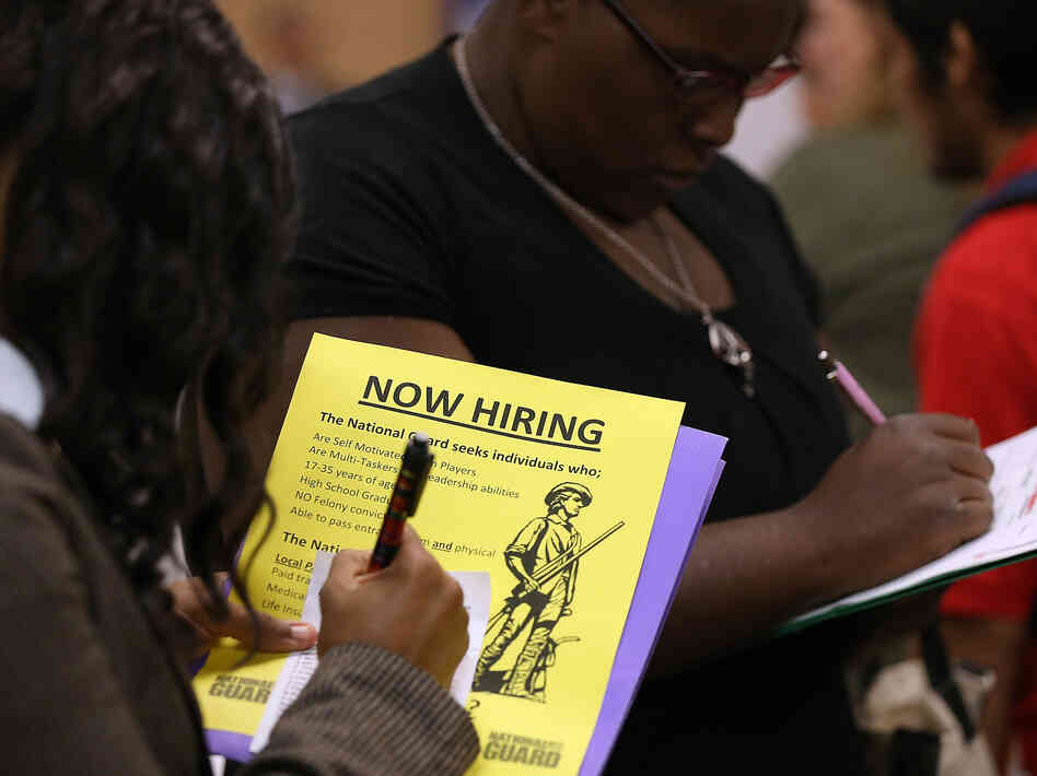 People looking for work were filling out applications earlier this month at a career fair in Emeryville, Calif.