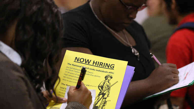 People looking for work were filling out applications earlier this month at a career