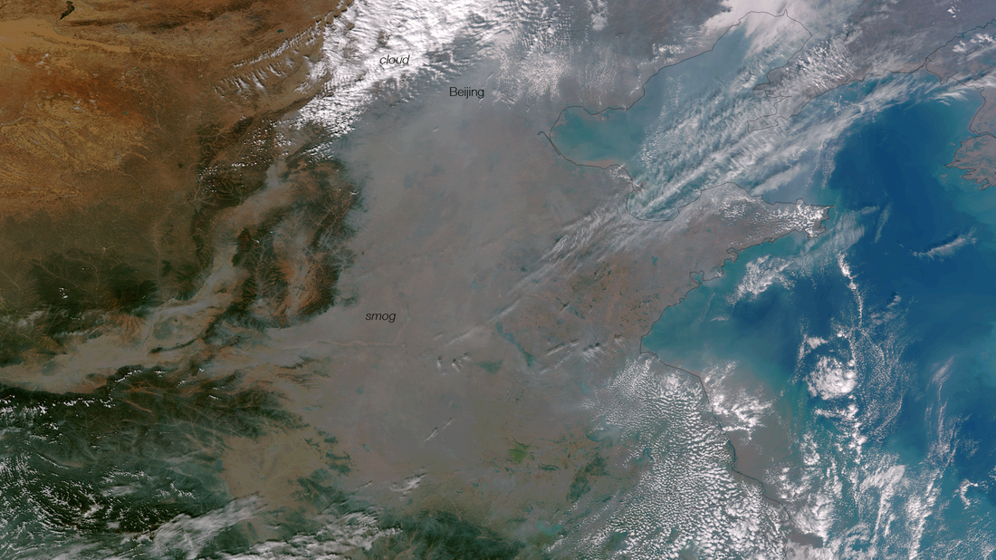 Heavy smog has shrouded much of eastern China, and air quality levels have been dropped to extremely dangerous levels. The heavy smog is caused by industrial pollution, coal and agricultural burning, and has been trapped by the mountains to the west and wind patterns. The thick haze of smog is clearly visible as the murky gray color in this true color satellite image.