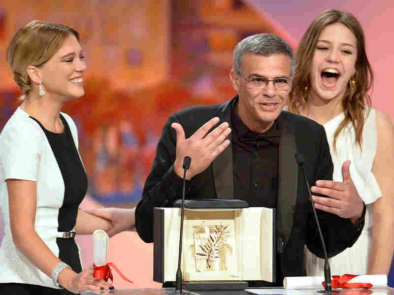 Abdellatif Kechiche speaks onstage at the Cannes Film Festival in May with Seydoux (left) and Exarchopoulos after all three were awarded the Palme d'Or for their work on Blue Is the Warmest Color, a festival first.