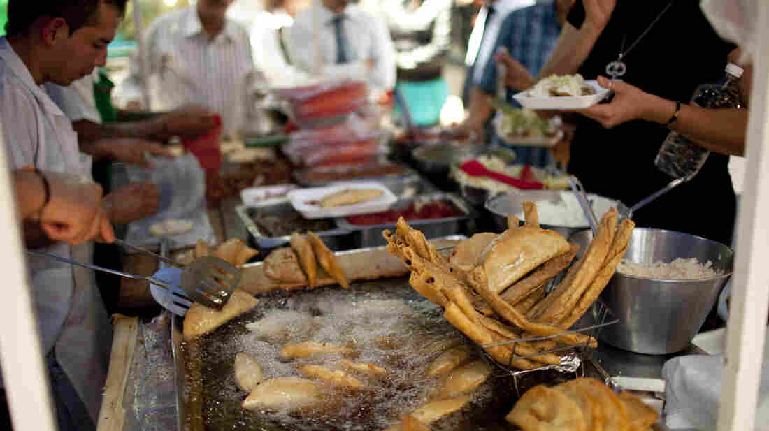 A street vendor fries food for lunch customers in Mexico City on July 10. Mexico has now surpassed the United States in levels of adult obesity, according to the U.N. Food and Agriculture Organization.
