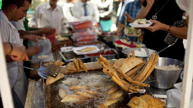 A street vendor fries food for lunch customers in Mexico City on July 10. Mexico has now surpassed the United States in levels of adult obesity, according to the U.N. Food