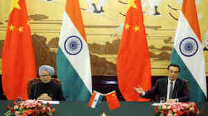 Chinese Premier Li Keqiang talks during a joint news conference with India's Prime Minister