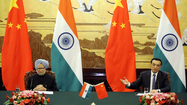 Chinese Premier Li Keqiang talks during a joint news conference with India's Prime Minister Manmohan Singh at the Great Hall of the People in Beijing on Wednesday.