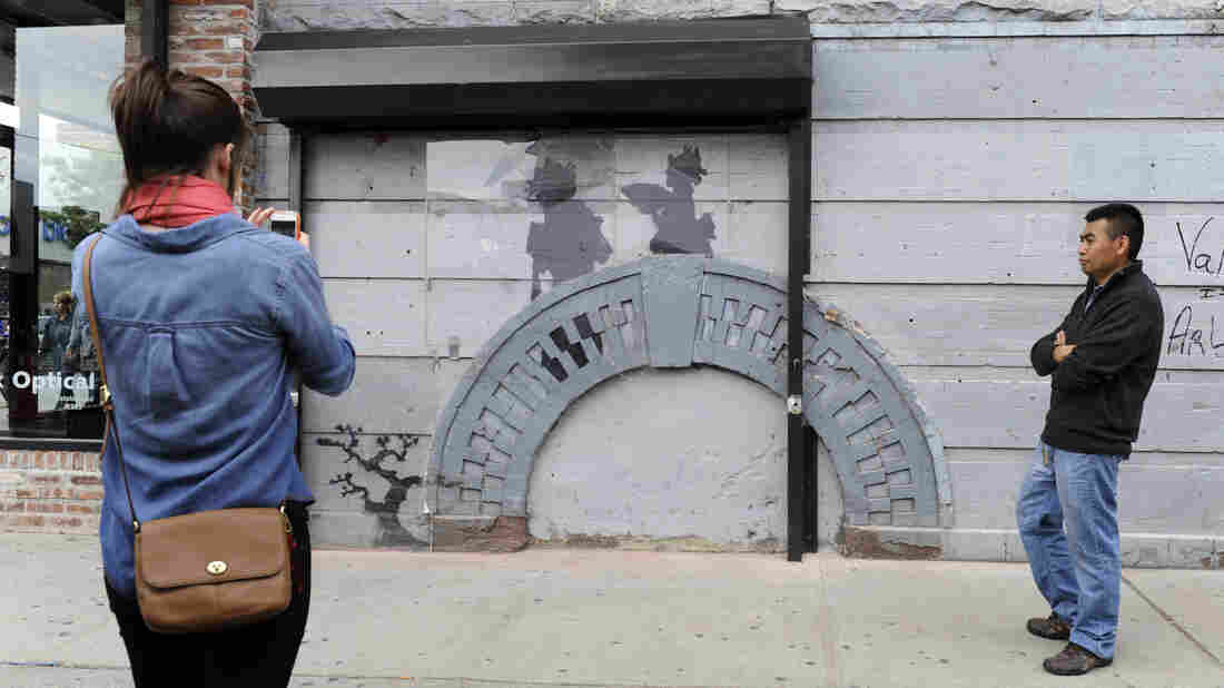 Cara Tabachnick's family owns the East Williamsburg building that Banksy chose as the canvas for one of his latest works. They installed a metal gate and commissioned a guard to protect the art from vandalism or removal.