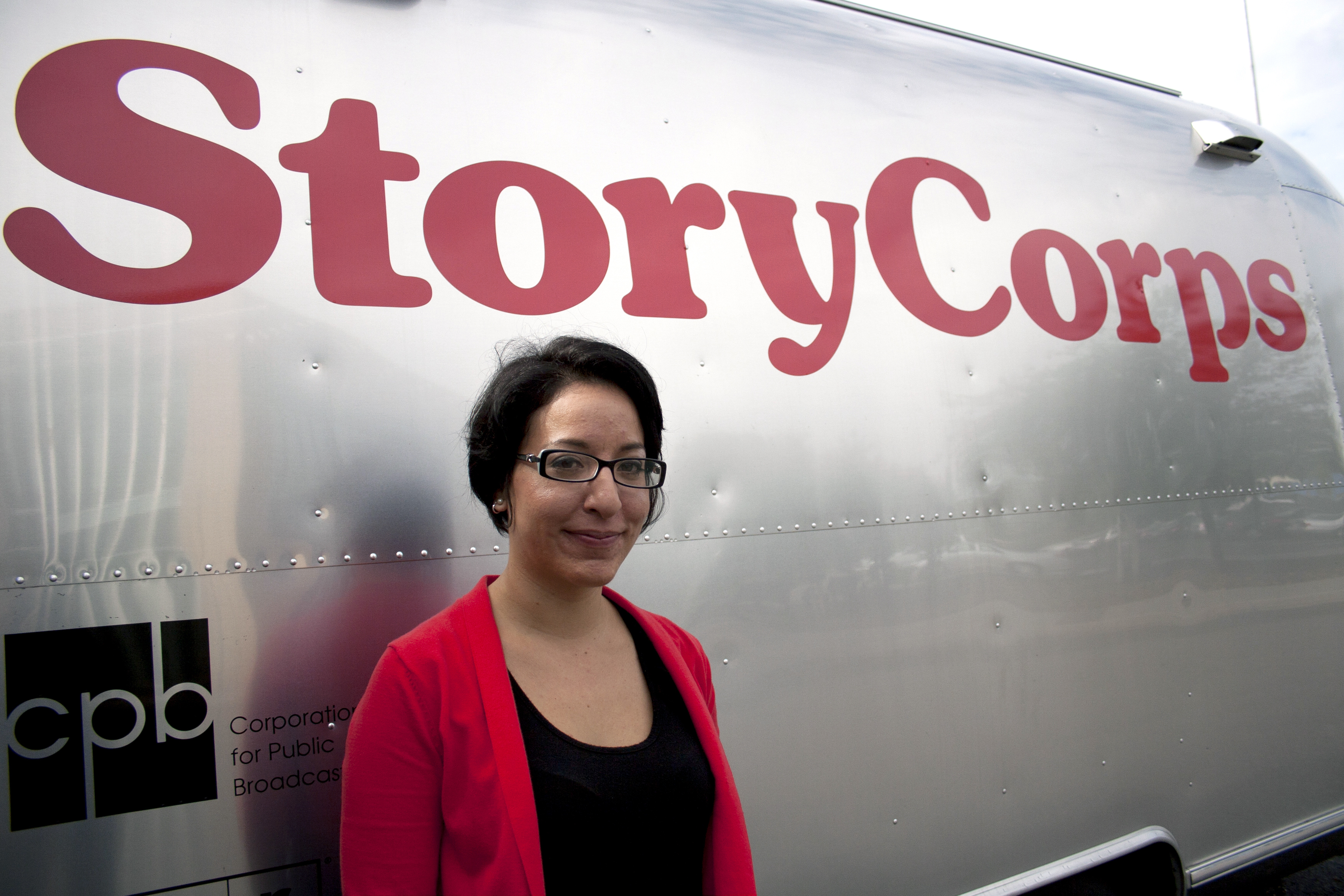 During a StoryCorps interview, participants can either talk to a friend or loved one, or StoryCorps facilitators like Virginia Lora, pictured, can conduct the interview. Facilitators also support the interviews with prompts or questions to drive the conversation, if needed.