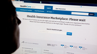 Heavy Internet traffic and system problems plagued the launch of the new HealthCare.gov insurance exchange site.