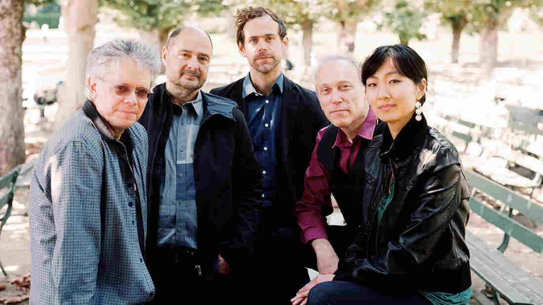 Kronos Quartet's new album, Aheym, comes out Nov. 5. All the music on this album was composed by Bryce Dessner (center) of the rock group The National.