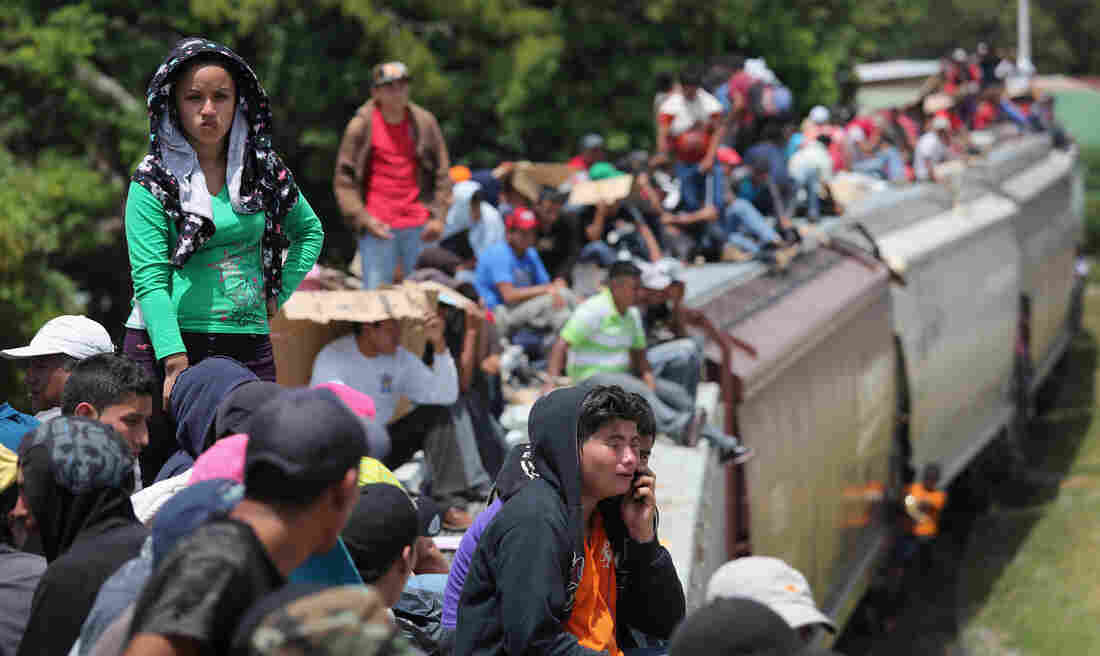 "Migrants ride the trains known as ""la bestia,"" or ""the beast,"" during their journey through Mexico to reach the U.S. border."