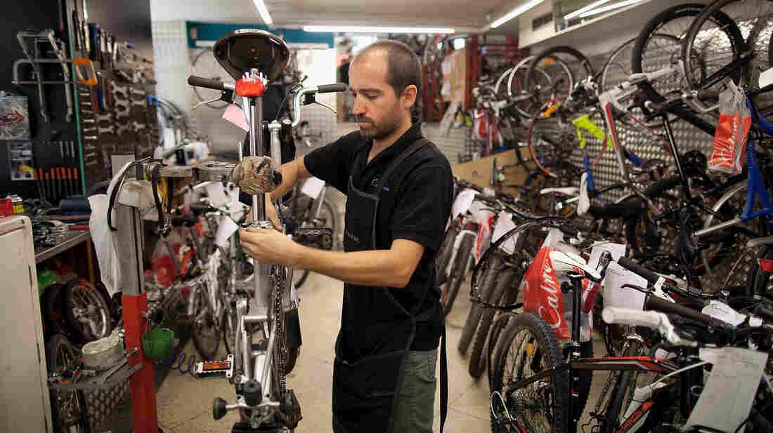 A mechanic repairs a bike at Calmera bike shop in Madr