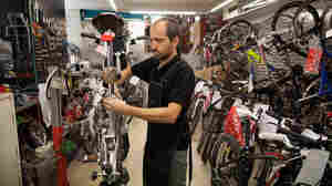 A mechanic repairs a bike at Calmera bike shop in Madrid in September. As car sales slump across Europe, bicycle sales in Spain are outpacing cars — a trend seen across much of the Continent.