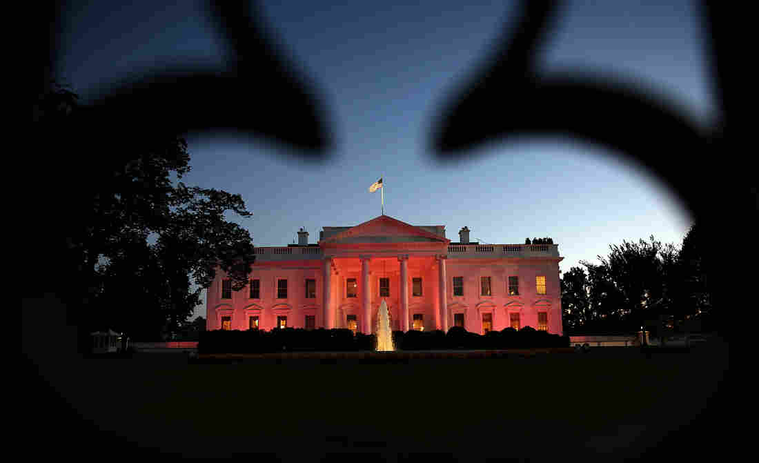 The White House is bathed in pink light on Thursday for National Breast Cancer Awareness Month.